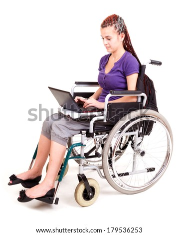 girl on wheelchair isolated on white - stock photo