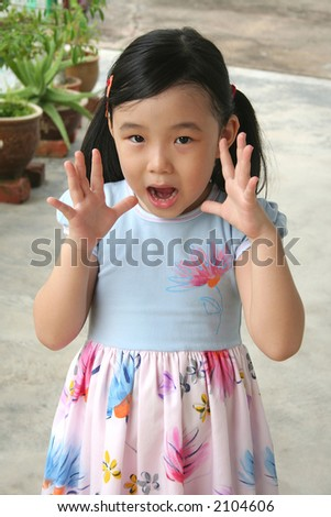 Girl open up hand showing shocked expression - stock photo