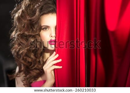 Girl opens the scenes  - stock photo