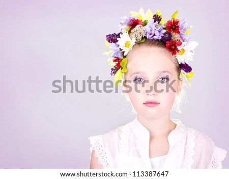 girl or teen with flowers in hair, light background - stock photo