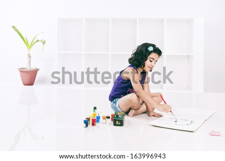 Girl painting with water colors - stock photo