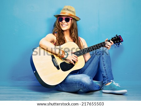 girl play music on acoustic guitar . hipster style portrait of young woman . - stock photo
