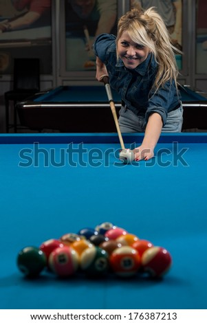 Girl Playing Billiards -  Lining To Hit Ball On Pool Table - stock photo