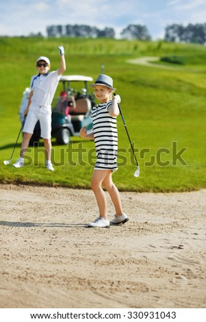 Girl playing golf and  enjoing on the successful hit - stock photo