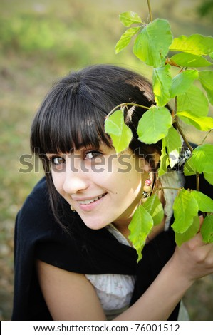 Girl playing in the park - stock photo