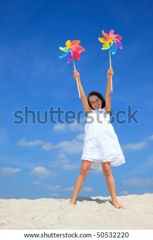 Girl playing on beach - stock photo