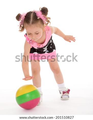 Girl playing with a ball on white background.happy childhood,sweet child having fun outdoor,playing isolated on white background, happiness concept,adorable child having fun in studio - stock photo