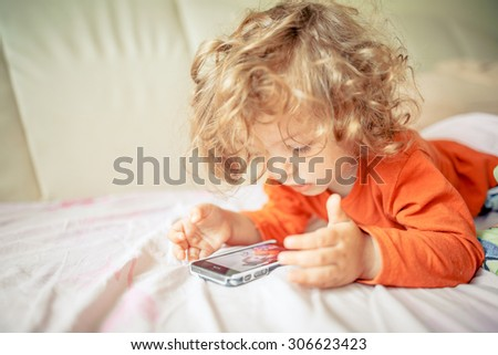 girl playing with a smartphone - stock photo