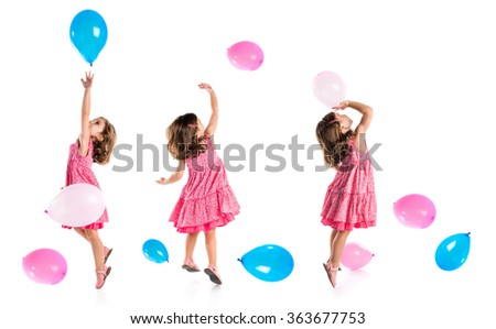 Girl playing with balloons - stock photo