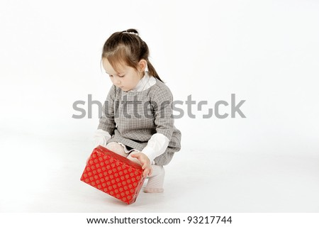 Girl playing with box - stock photo