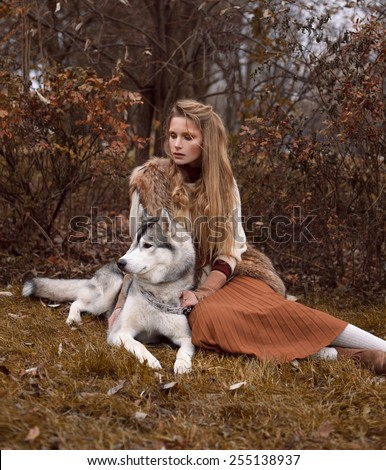 Girl playing with her husky dog in the park, autumn. Fashion blonde stylish woman. Outdoors. Beauty nature.  - stock photo