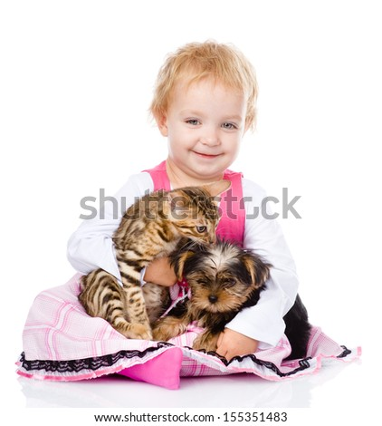 girl playing with pets - dog and cat. looking at camera. isolated on white background - stock photo