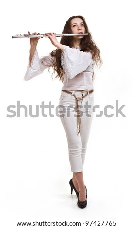 girl plays the flute on a white background - stock photo