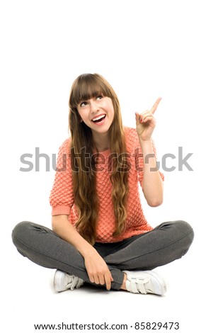 Girl pointing finger - stock photo