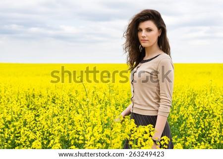 girl portrait in yellow flower field - stock photo