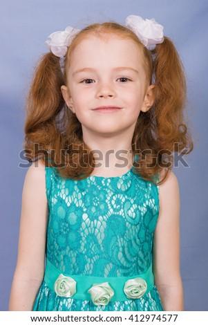 girl portrait. portrait of girl on blue background, portrait of preschool girl. Cute little girl smiling  - stock photo