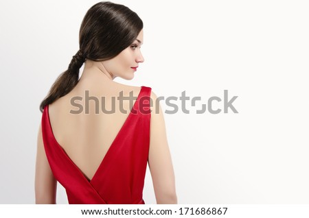 Girl posing fashion in sexy red dress with naked back - stock photo
