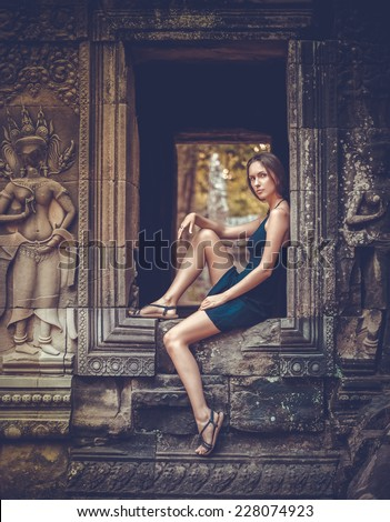 Girl posing in Angkor Wat Temple, Cambodia - stock photo