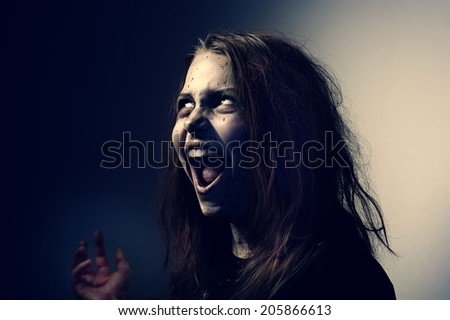 Girl possessed by a demon. In Conspiracy With Satan - stock photo