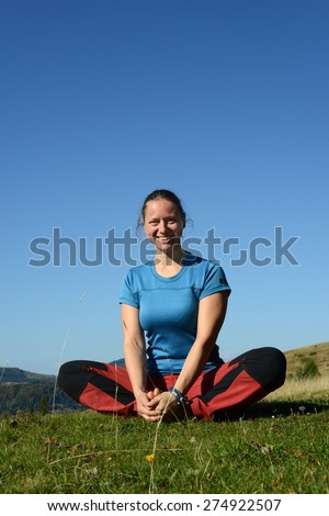 Girl practicing yoga outdoors - stock photo