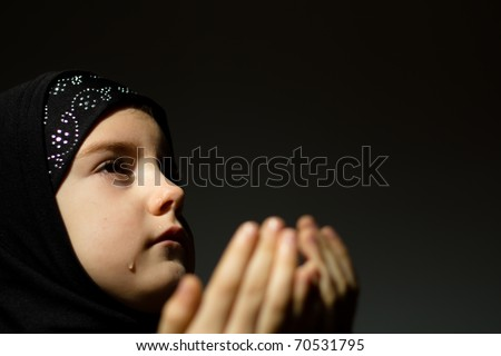 Girl praying with tear on face - stock photo