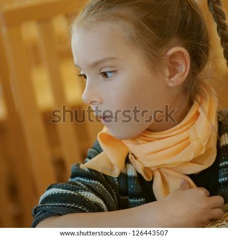 Girl-preschooler to profile in cozy restaurant. - stock photo