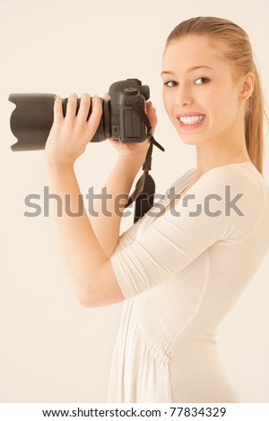Girl profile with mirror camera on grey background. - stock photo