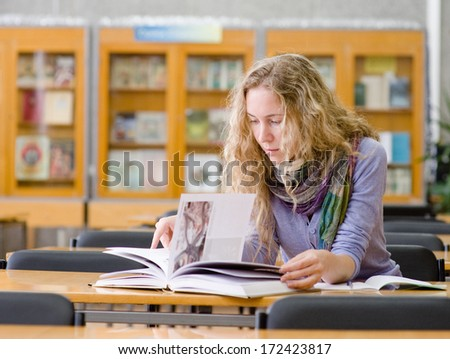 girl read book in library - stock photo