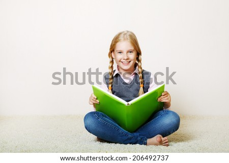 girl reading a book. School and education - stock photo
