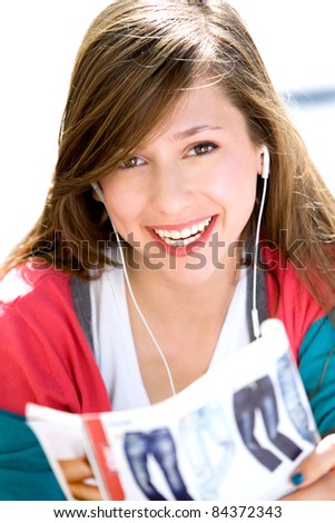 Girl reading fashion magazine - stock photo