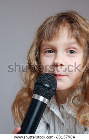 girl ready to sing funny song. - stock photo