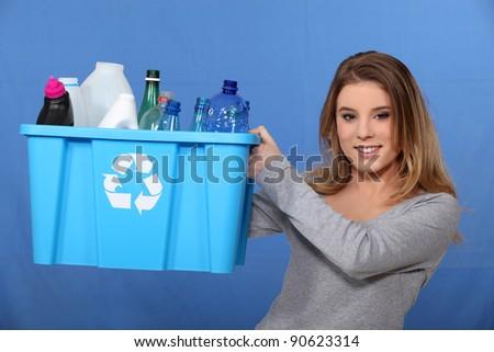 Girl recycling plastic bottles - stock photo