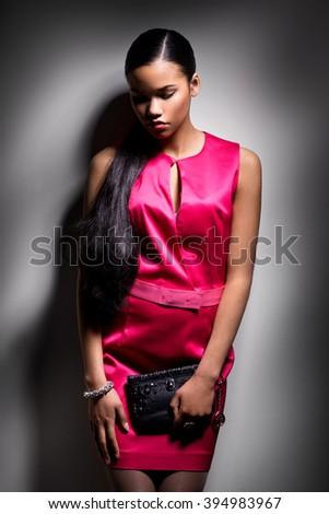 girl red dress studio - stock photo