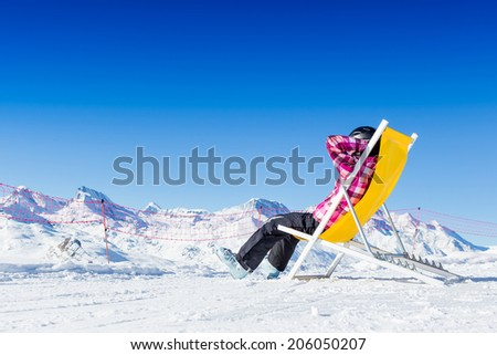 Girl relax in snowy mountains. Ski vacation  - stock photo