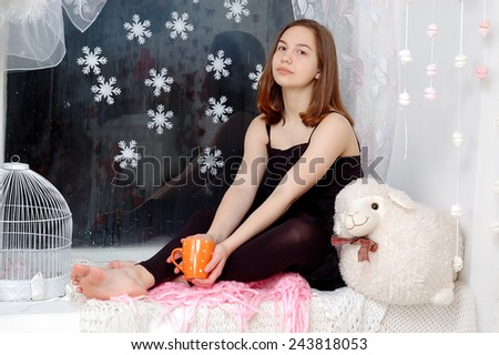 girl relaxed at home in winter holiday and enjoy a warm drink  - stock photo