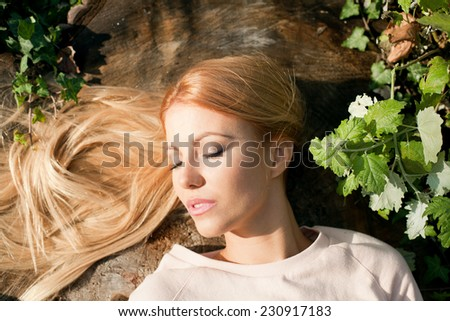 Girl relaxing in autumn park - stock photo