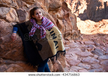 Girl relaxing in mountains - stock photo