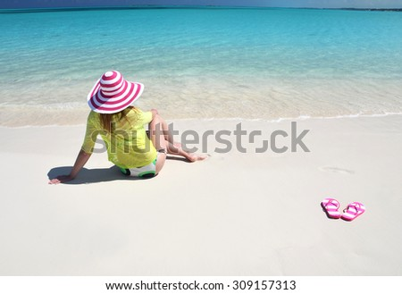 Girl relaxing on the beach of Great Exuma, Bahamas - stock photo