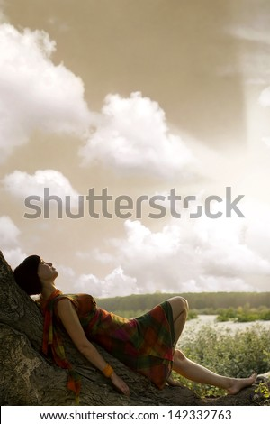 Girl resting and enjoying the sun - stock photo