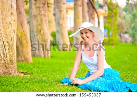 Girl resting on the lawn and laughs gaily - stock photo