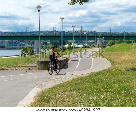girl rides a bicycle in the city - stock photo