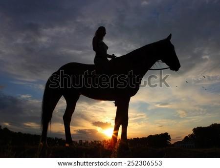 Girl riding saddlebred horse in sunset - stock photo