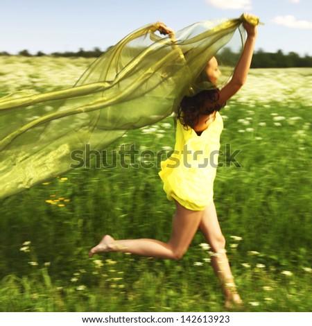 girl run  fabric in she hands - stock photo