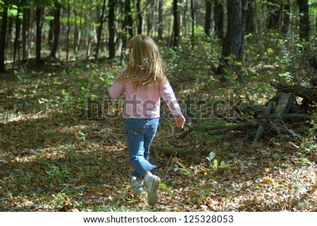Girl Running In Woods - stock photo