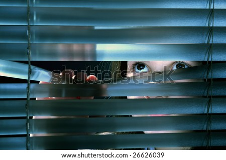 Girl S Eyes Looking Through Window Blinds Stock Photo