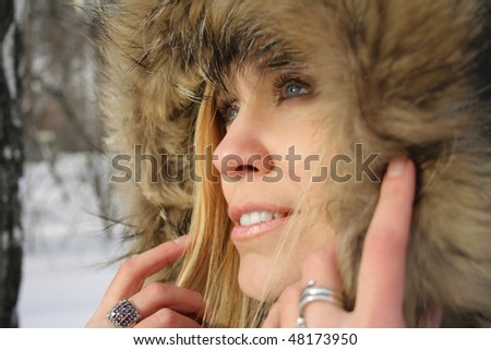Girl's face in a hood. Focus on face - stock photo