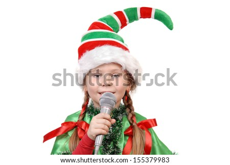 Girl - Santa's elf with a microphone isolated on a white background - stock photo