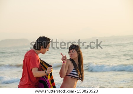 Girl scolding a guy that is stalking her - stock photo