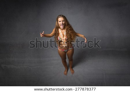 girl screaming, dark and abstract background - stock photo