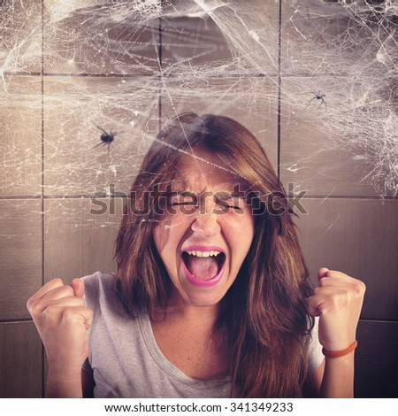Girl screaming trapped in a spider web - stock photo